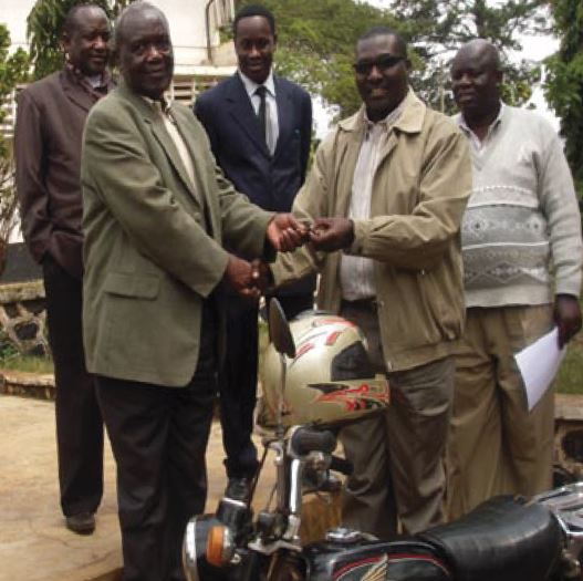 The CNCC Founder, Michael Shirima handing over the motorcycle to the Rombo District Commissioner on the 27th August, 2010